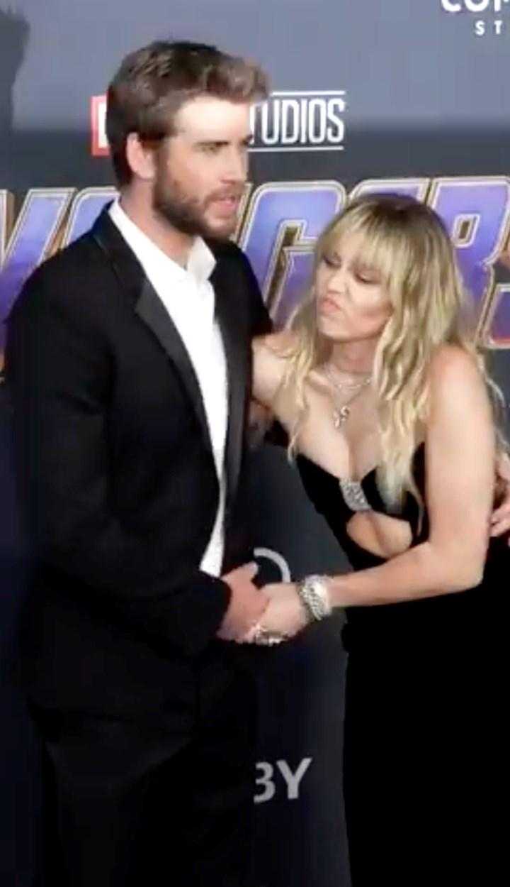 WATCH: Footage of Miley snapping and shoving Liam at a red carpet appearance has emerged